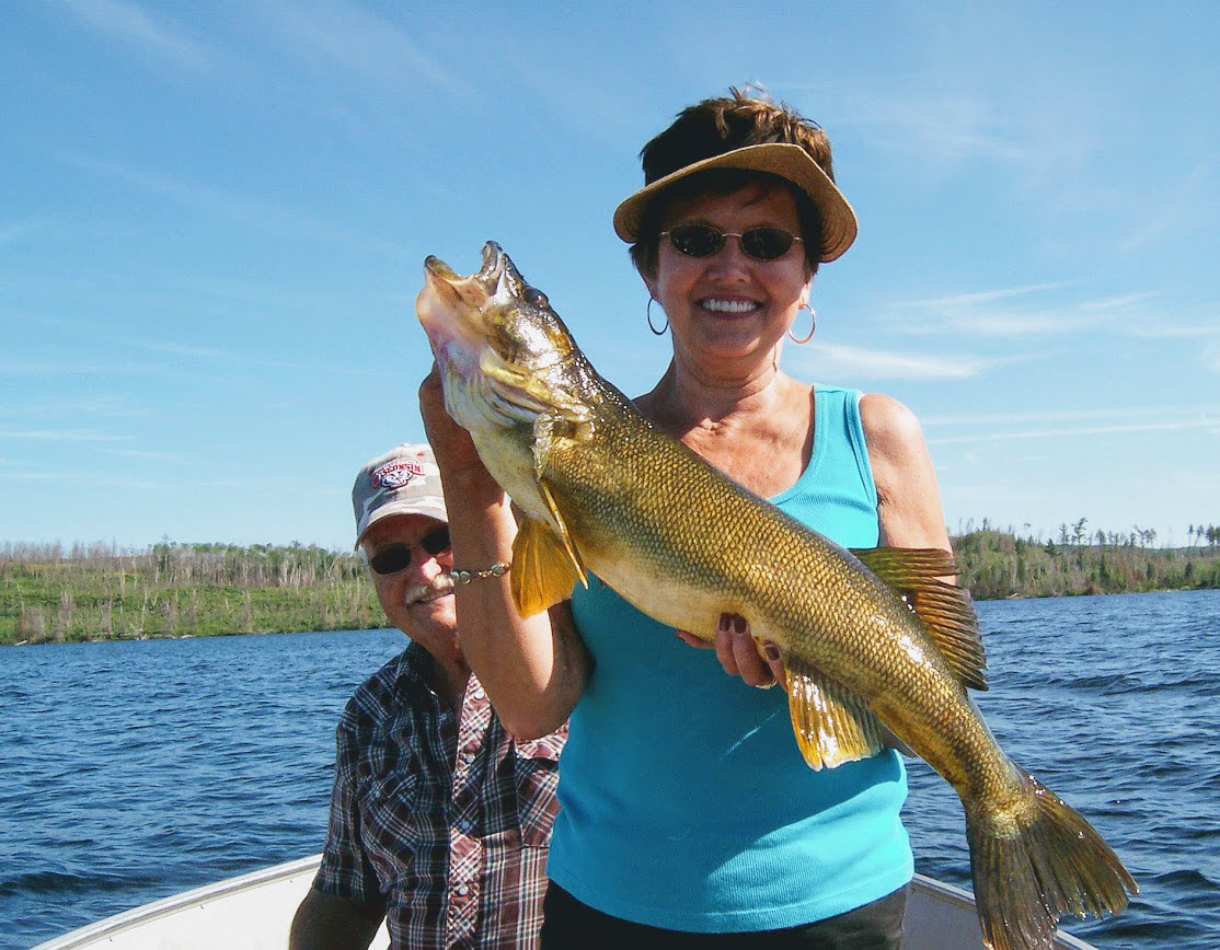 Gunflint Lodge woman with fish